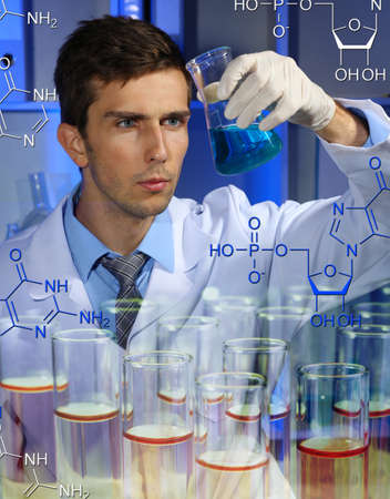 Young laboratory scientist working at lab photo