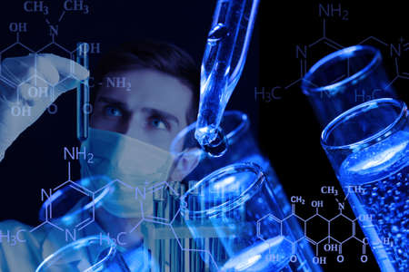 Young scientist working at lab photo