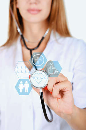 physiotherapist: Female doctor with stethoscope and virtual screen Stock Photo
