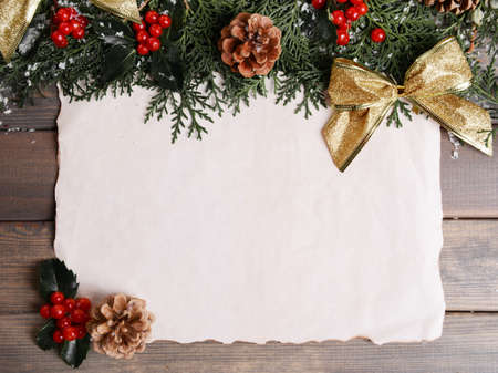 white frame: Christmas card on wooden background
