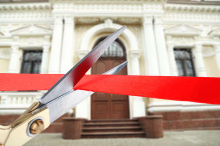 building color: Grand opening, cutting red ribbon