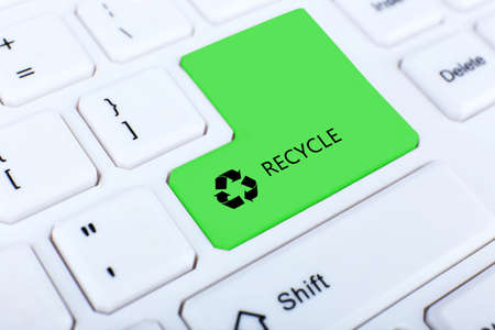 Recycle concept, close up of keyboard, recycle button photo
