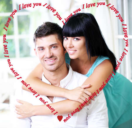 romantic couple: Beautiful young romantic couple and heart-shaped frame Stock Photo