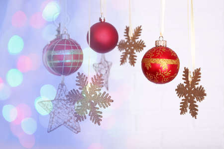 Christmas decorations hanging on festive background photo