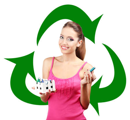 Recycle concept, beautiful young woman holding batteries isolated on white photo