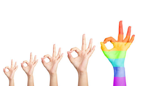 Mans hands isolated on white, one hand painted as rainbow flag photo