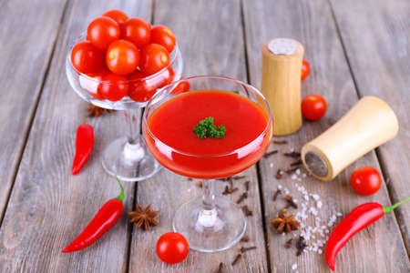 goblet: Tomato juice in goblet and fresh vegetables on wooden background Stock Photo