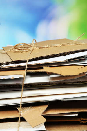 wastepaper: Big stack of papers on blue background, close-up