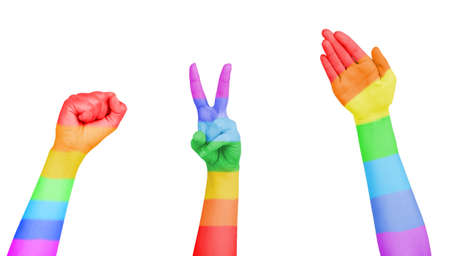 Mans hands painted as the rainbow flag isolated on white photo