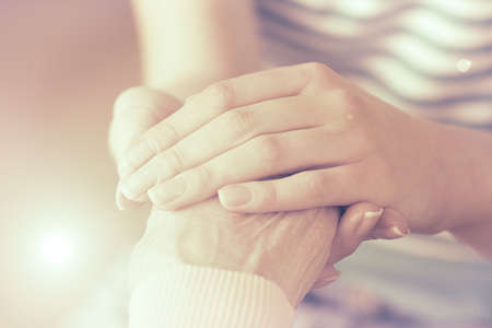 old carer: Helping hands, care for the elderly concept Stock Photo