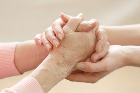home care nurse: Helping hands, care for the elderly concept Stock Photo