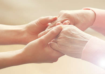 carer: Helping hands, care for the elderly concept Stock Photo