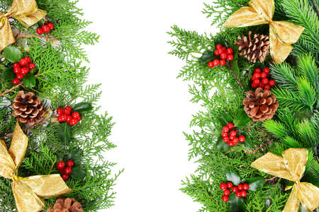 christmas beads: Beautiful Christmas border from fir and mistletoe on white background Stock Photo