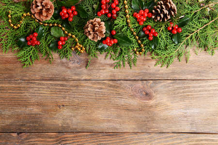 with mistletoe: Beautiful Christmas border from fir and mistletoe on wooden background