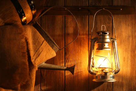 warm things: Lantern hanging on hook on wooden wall