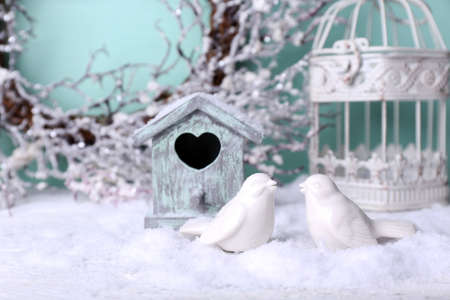 Beautiful Christmas composition with small bird house photo
