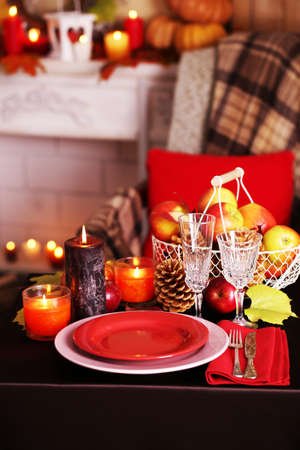 Festive autumn serving table in room photo
