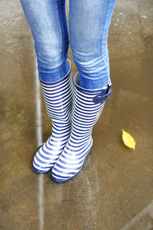wellies: Girl in rubber boots outdoors in autumn Stock Photo