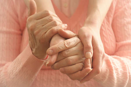 caretaker: Helping hands, care for the elderly concept Stock Photo