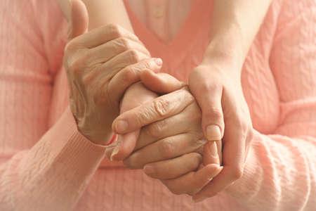 Helping hands, care for the elderly concept Foto de archivo