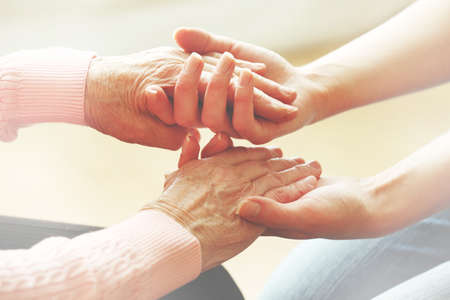 elderly adults: Helping hands, care for the elderly concept Stock Photo