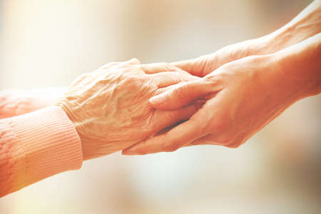 seniors: Helping hands, care for the elderly concept Stock Photo