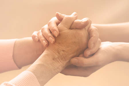 old hand: Helping hands, care for the elderly concept Stock Photo