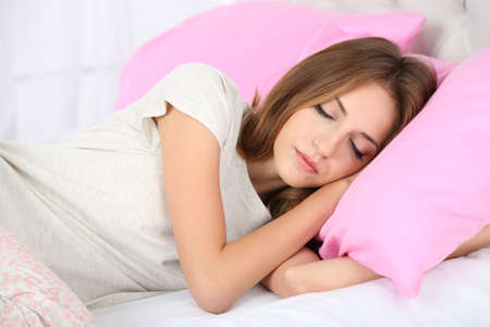 woman laying: Young beautiful woman sleeping in bed close-up