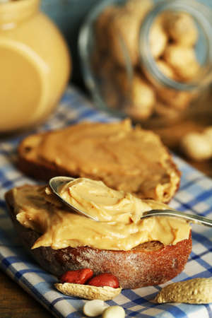 Beautiful still life with fresh peanut butter, close up photo
