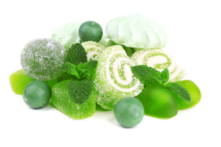 kiss biscuits: Mint color meringues, mint jelly candies isolated on white