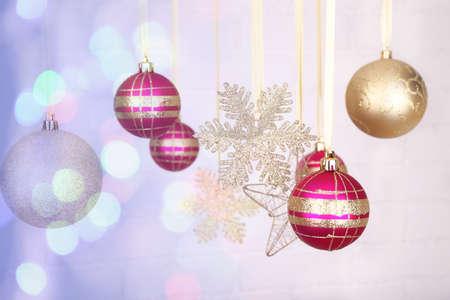 Christmas decorations hanging on festive background photo