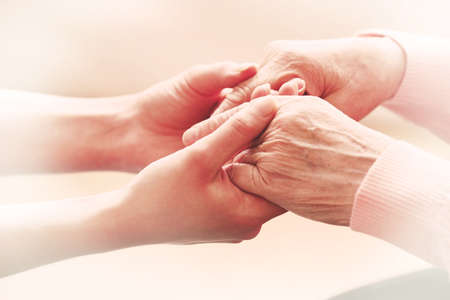 disabled seniors: Helping hands, care for the elderly concept Stock Photo