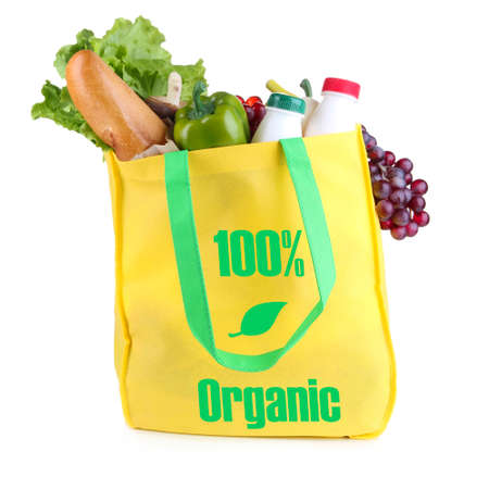 Yellow bag with organic products isolated on white photo