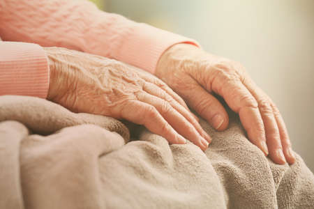 elderly adults: Elderly womans hands, care for the elderly concept