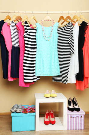 cotton dress: Female dresses on hangers in room