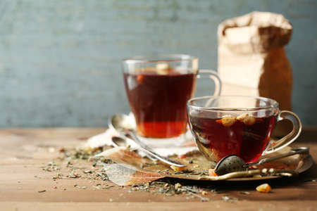Beautiful vintage composition with herbal tea, on wooden table Stockfoto