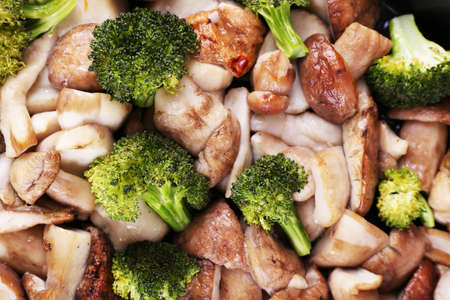 braised mushrooms: Braised wild mushrooms with vegetables and spices close-up background Stock Photo