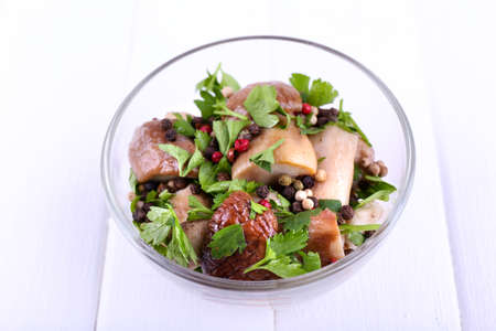 braised mushrooms: Braised wild mushrooms with vegetables and spices in bowl on table Stock Photo