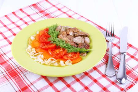 braised mushrooms: Braised wild mushrooms with vegetables and spices on plate on table