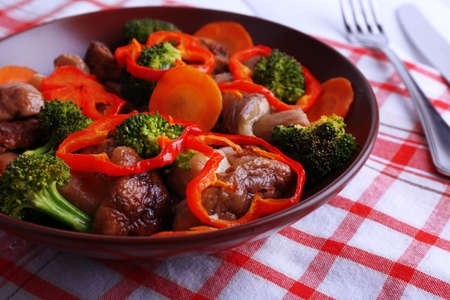 braised mushrooms: Braised wild mushrooms with vegetables and spices on plate on table
