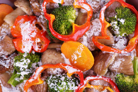 braised mushrooms: Braised wild mushrooms with vegetables and sauce close-up