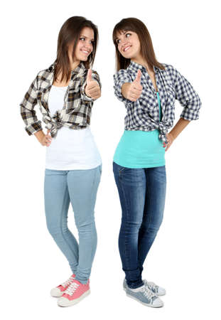 cute teen girl: Beautiful girls twins isolated on white