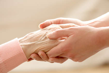 female senior adults: Helping hands, care for the elderly concept Stock Photo