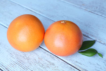 grapefruits: Ripe grapefruits on wooden background Stock Photo