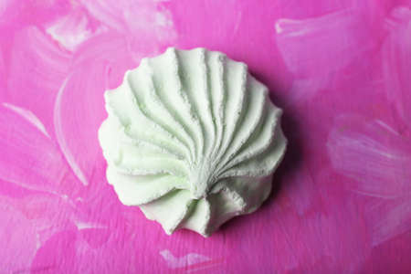 kiss biscuits: Mint color meringues on color background