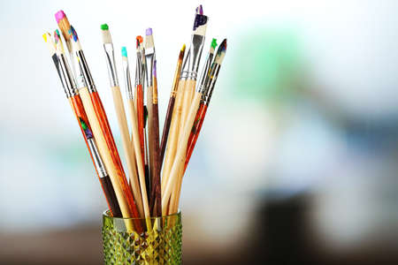 Paint brushes with paints on bright  Stock Photo