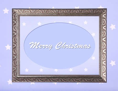 Christmas greeting card with frame on purple background photo