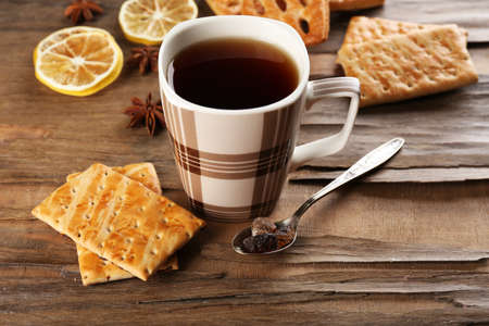 Cup of tea with cookies on table close-up photo