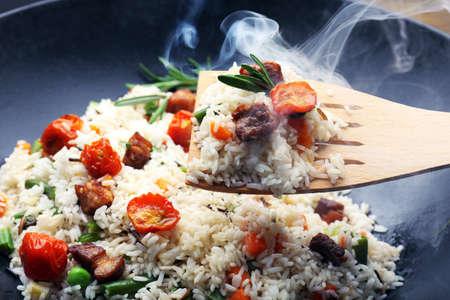 wok: Tasty rice preparing in wok, close-up