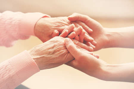 old people in care: Helping hands, care for the elderly concept Stock Photo